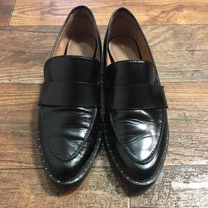 Black studded loafers